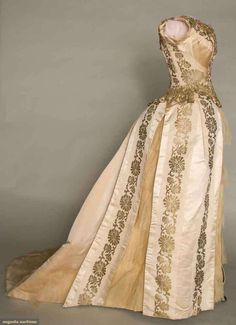 """Ball Gown, Parcher: ca. 1880-1885, stripes of alternating faille and silk satin, brocade stylized flower band with faille, metallic bobbin lace trim, tulle flounce, satin train. Petersham label: """"Parcher.""""   Augusta Auctions, March 30, 2011 - St. Pauls, Lot 153"""