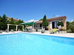 This beautiful Provençal home enjoys exceptional view and a  private outdoor swimming pool.