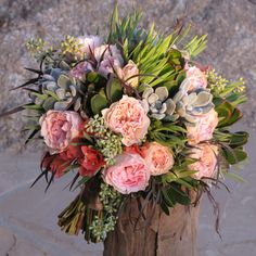 "hand-tied bouquet with pink bougainvillea, Juliette Drouet garden roses, Echeveria ""frosty,"" seeded eucalyptus, green leucadendron and agonis"