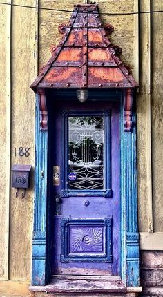 Victorian Village, Columbus, Ohio  ~~  blue with lyre grill inset in window.  Rusty overhang.