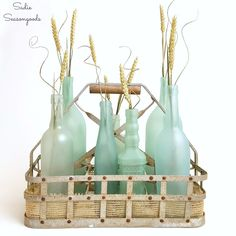 Again, love the mix of sea glass bottles and styles (not the wheat or basket). Could maybe do it myself and bring them? DIY Sea Glass Bottles for Summer Decor