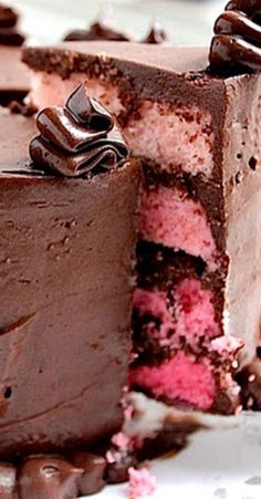 Pink Ombre Layer #Cake with Crispy Chocolate Filling and Sour Cream #Chocolate Frosting ~ Says: this cake is amazingly soft and not to mention pretty. The chocolate frosting is just amazing!