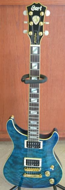 Cort Matt Murphy Signature Series Electric Guitar (Quilted Maple Blue)*Carry Case Not IncludedNice guitar, very good condition, clean in