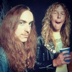 Cliff Burton and James Hetfield-Metallica..............