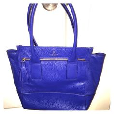 Kate Spade blue tote! This bag is huge and perfect for keeping all of your things safe. It's an awesome blue color the picture is perfect for showing the color. It has only been worn a handful of times! There is one small spot on the bottom interior but the outside is like new! It is a leather exterior kate spade Bags Totes