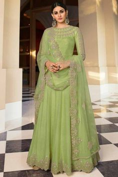 Look fabulous and beautiful by wearing this pistachio green dupion silk anarkali suit which will instantly catch your fancy. This round neck and full sleeve suit designed with stone and zari work. Available with santoon/ lycra churidar in pistachio green color with pistachio green net dupatta. Churidar is plain. Dupatta beautified with stone and zari work. #anarkalisuit #usa #Indianwear #Indiandresses #andaazfashion Net Blouses, Net Saree, Anarkali, Salwar Kameez, Sari, Formal Dresses, Stone, Green, Purpose