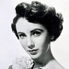 Elizabeth Taylor... iconic for her violet eyes, National Velvet, Cleopatra, numerous love affairs and Hollywood glamour on her own terms.