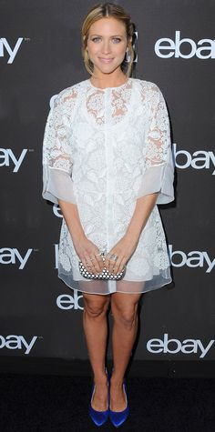 Brittany Snow styled her sweet silk floral-embroidered Blumarine LWD with a graphic metal Oroton clutch, a Pamela Love ring, and blue satin Brian Atwood pumps.