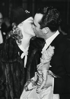 Ginger Rogers and Harold Lloyd share a kiss at the Shrine Flood Relief Benefit in Hollywood, February, 1937.