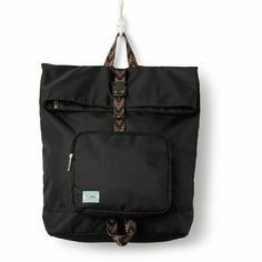 Toms Stand Up Black Backpack Front zip pocket and adjustable strap. Padded laptop compartment. Zip top and buckle closure. Aztec/tribal detailing on straps and handle. TOMS Bags Backpacks