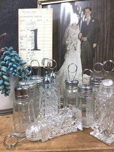 Table Number Holders 10 Crystal Glass Vintage Wedding Eclectic Mix Salt Pepper Shakers Re-purposed Photo Or Menu Display Wedding Table Number Holders, Wedding Table Numbers, Salt Pepper Shakers, Vintage Wedding Favors, Display, Reception Table, Different Shapes, Crystals, Card Sizes