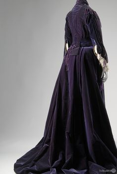 "House of Worth afternoon dress, 1903. From the collection of The Museum at FIT.  By virtue of its ""imperial"" purple velvet and long train, this gown conveys a message of exalted status. Prior to the development of synthetic dyes, purple was expensive to produce, and its use was restricted by sumptuary laws."
