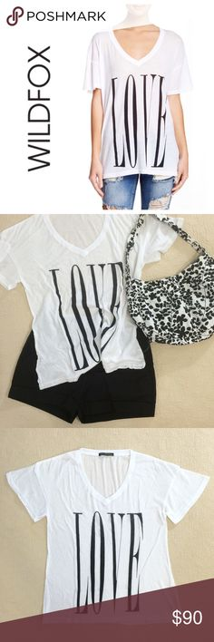 """Wildfox Big Love Oversized Graphic V-Neck Tee A super comfy, oversized graphic tee. Short-sleeve, v-neck, and perfect for casual days. This is a size XS, but could easily fit anyone up to a L.  Vince Camuto shorts and black and white floral purse pictured are available separately for purchase.  Approximately 26.5"""" long. Approximately 20"""" across the bust, laid flat.  Model is 5'9"""" 34-23-34 and is wearing a size S.  50% cotton 50% polyester  ❌ Sorry, no trades. Wildfox Tops Tees - Short Sleeve"""