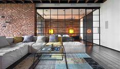Her er boligen som giver dig lyst at rive vægge og lofter ned. Her står rå bjælker og murstensvægge i skarp kontrast til vægge af planter, hvilket sammen skaber denne unikke og industrielle lejlighed.