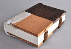 Full leather Late Byzantine Binding Model by Anna Embree; Byzantine Empire; c. 11-15 centuries. Full goat leather; unsupported link stitch sewing; raised endbands; blind tooling; braided straps with brass clasps. Dimensions: 22.5 x 15 x 6 cm.
