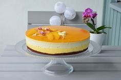 Cheesecake with brownie base, mango, peach and white chocolate