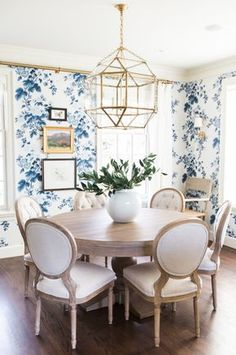 Updated Traditional blue and white dining room - brass geometric chandelier, brass curtain rod and linen covered dining chairs