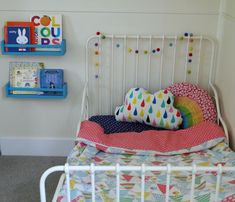 IKEA hack shelves and colourful toddler room