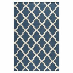 Bring a pop of style to your living room or master suite with this hand-tufted wool rug, showcasing a chic Moroccan trellis motif.     Product: Rug  Construction Material: 100% WoolColor: Navy blue  Features: HandmadeTufted  Note: Please be aware that actual colors may vary from those shown on your screen. Accent rugs may also not show the entire pattern that the corresponding area rugs have.