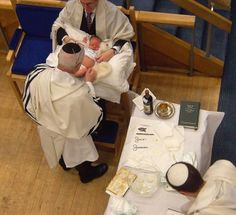 A baby boy having his Brit Milah ( Jewish ceremony of circumcision done 8 days after his birth by a mohel)
