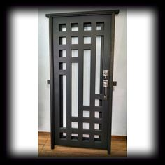puerta principal de forja contemporanea