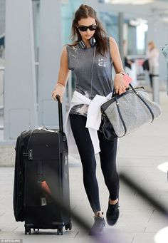 Casual: The Russian model was alone as she hurried to catch a flight in a grey vest and sp...