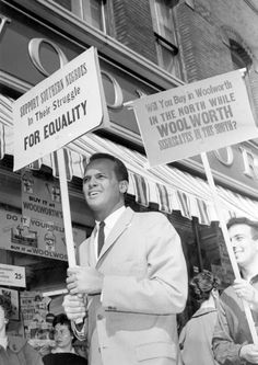 Harry Belafonte leads a line of picketers from Harvard and surrounding colleges in protest against lunch counter segregation in the South. Students picketed the Woolworth store in Harvard Square, Cambridge, Mass., April 21, 1960. (J. Walter Green/AP)