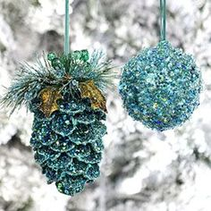 To recreate the blue glittered ornaments, I would buy spray adhesive, glitter, and go in search of pinecones or other found objects. The spray adhesive is pretty nasty - so if you can, spray outside. I spray items inside a box to contain the extraneous spray, then sprinkle on the glitter. For the really heavy coverage, such as shown, rolling in glitter might do better. Have fun!