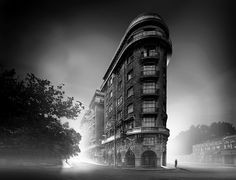 shot during the day using ND filters, visually striking art deco structures are re-imagined as dark, foreboding scenes.