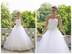 Strapless tulle and lace ball gown wedding dress with scalloped neckline. Embellished hand-beaded lace bodice with three-dimensional detailing and Swarovski crystals. Softly gathered full tulle skirt with matching lace appliqu