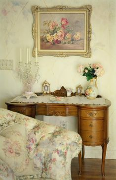 This is really cute. Love the subdued feeling with the faded roses and sofa fabric. It all makes me feel good just looking at it.