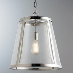 Seeded Glass Transitional Pendant  1 Light Combining the traditional profile of a tapered shade with on-trend seeded glass, the polished nickel frame and the square-linked chain gives the Seeded Glass Transitional Collection an elevated, contemporary yet delicate look. (17.25''Hx16''W).