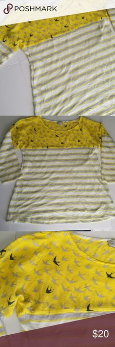 Anthropologie Bird and Stripe Print Top Anthropologie Bird and Stripe Print Top  *Light grey and bright yellow stripe pattern with grey and black bird print on top *3/4 length sleeves *Slightly shorter in the front and longer in the back *100% Cotton *Size Medium *Excellent pre-owned condition  **Stock photo is the same shirt but different color. Used for fit purposes only! Anthropologie Tops