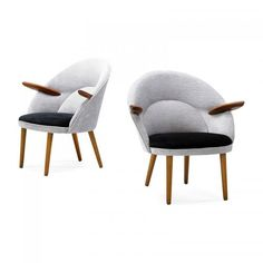 ERIC OSTERMANNEGON OLSEN MOBELFABRIK Pair of lounge chairs, Denmark, 1950s Beech, teak, upholstery Unmarked 31 x 30 x 26