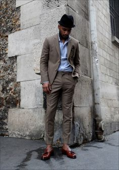 Kenzo khaki suit, Ralph Lauren shirt, Anthony Peto hat, Moscot-Miltzen sunglasses
