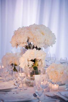 Beautiful white floral centerpieces.