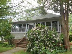 Four-season front porch expands iiving space in this charming bungalow
