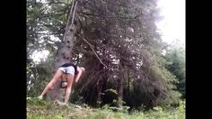 Hot Girl Cuts Down Tree in Short Shorts and Tank Top.