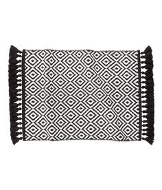 Check this out! Reversible, jacquard-weave bath mat in cotton with fringe along short sides. - Visit hm.com to see more.