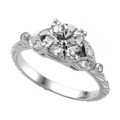 Looks almost exactly like my vintage engagement ring: My grandfather gave this ring to my grandmother in 1939.