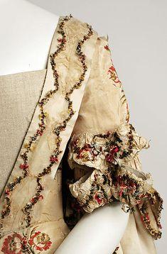 Detail of Robe à la Française, the Met Robe à la Française Date: 1760–80 Culture: British Medium: silk Dimensions: Length (a): 63 in. (160 cm) Length (b): 8 in. (20.3 cm) Length (c): 43 in. (109.2 cm)
