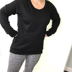 Women's lounger is a roomy tunic style sweater with a high/low hem.