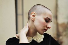 shaved head / buzz cut / strong brows / lipstick / cute collar