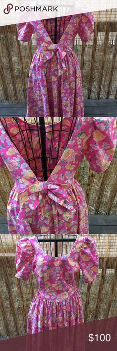 Laura Ashley vintage bow dress Super cute! Darling dress that's reminiscent of the 70s or 80s. This dress was made in Great Britain and is in awesome condition! Laura Ashley Dresses