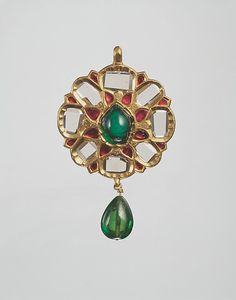 Floral Pendant in the Form of an Eight-Pointed Star. first half of 17th century. Islamic. Floral Pendant with Upswept Petals (first half 17th century, Islamic) Fabricated from gold; worked in kundan technique and set with diamonds, rubies and emeralds; with pendant emerald bead.