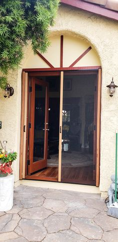 We installed Mahogany Wood Veneer Double Retractable Screen Doors on a set of French front doors in Simi Valley, California! For wooden front doors in need of Retractable Screens to match, call the Classic team! Visit www.chiproducts.com to see all of the many features we offer for you to customize your Retractable Screens, or call (866) 567-0400 for a free estimate! Retractable Screen Door, Wooden Front Doors, Simi Valley, Screen Doors, Ventura County, Wood Veneer, Orange County, Shutters