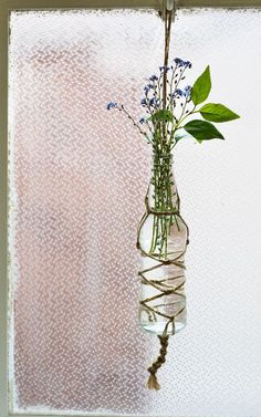 Knotted macrame bottle vase