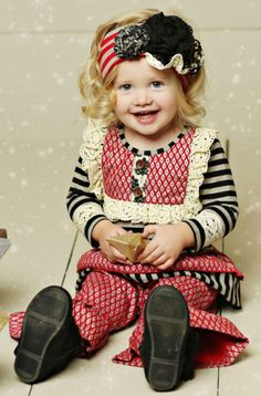 The Colette Holiday Romper Set features cherry red pattern, black stripes and lots of vintage lace!  This long sleeve two piece set for newborn and infant girls is adorable as a Christmas set for baby girls.  A perfect outfit for those precious first Christmas photos and upcoming festive events.