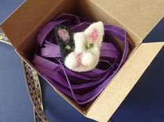 Cat Pin Brooch | Needle Felted Cat Brooch    I really hope you love this adorable little needle felt cat brooch.    The natural wools I use are a mixture of Shetland, Dorset and Border Leicester-cross.    The cute black and white cat is a very cute fashion accessory and makes a wonderful and thoughtful birthday, anniversary or Mother's Day gift. It would make a fab Easter gift too or a gift for a cat lover and is something charming to cherish forever.    Your needle felt cat brooch will come…