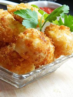 CRISPY FRIED CAULIFLOWER  1 medium sized Cauliflower  1/2 cup Cornmeal  3/4 cup Flour  1/2 cup Milk  2 Eggs  1 1/2 cups Bread crumbs  Salt & Pepper according to taste (or use your favourite spices)  Oil for deep frying